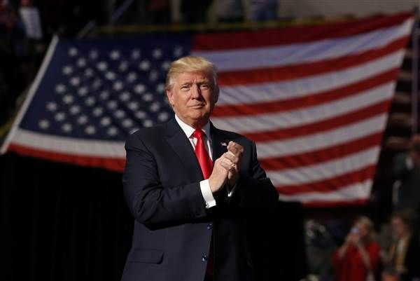 Image: U.S. President-elect Donald Trump arrives to speak during a USA Thank You Tour event at Giant Center in Hershey, Pennsylvania