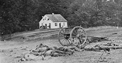 This photograph of a scene in Antietam, Md. shows bodies, possibly moved in order to keep the church in the background. The photograph was taken by Alexander Gardner, who worked for a time as an assistant to Matthew Brady.
