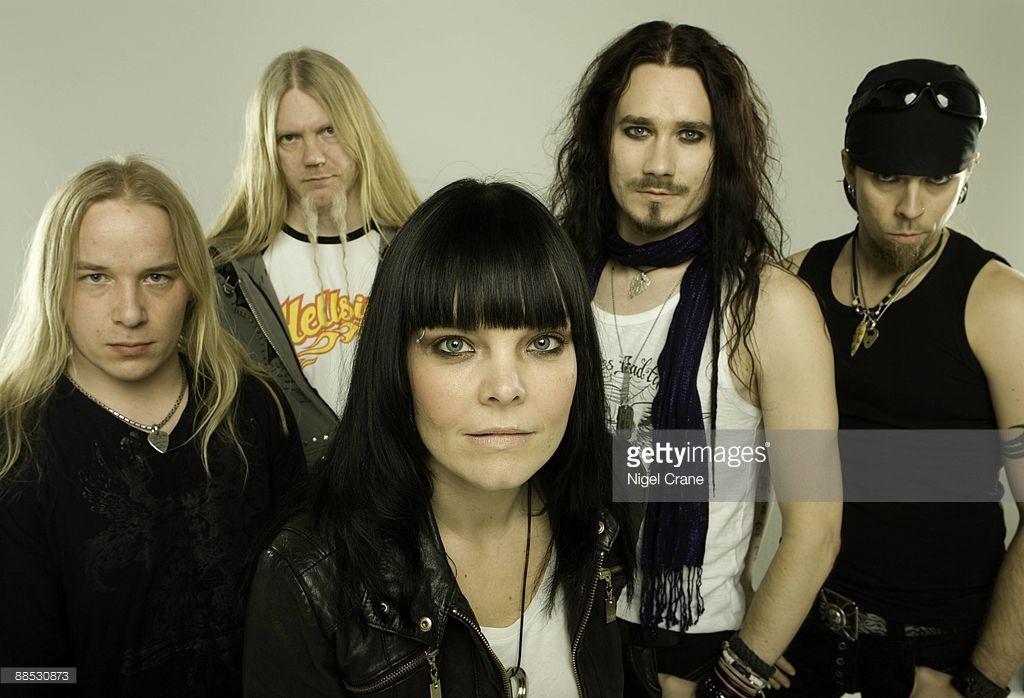 Posed studio group portrait of Finnish metal band Nightwish. Left to right are Emppu Vuorinen, Marco Hietala, Anette Olzon, Tuomas Holopainen and Jukka Nevalainen in London, England on March 25 2008.