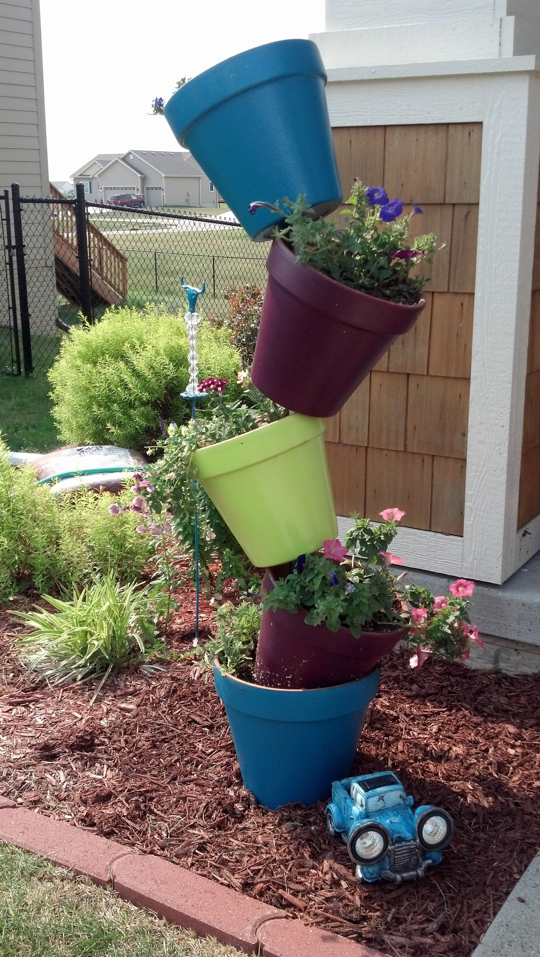 Her Pinspiration Leaning Tower Of Flowers Flower Pot Tower Flower Pots Outdoor Flower Pots