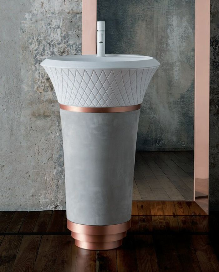 A Concrete And Copper Free Standing Sink With A Pattern Looks Eye Catchy