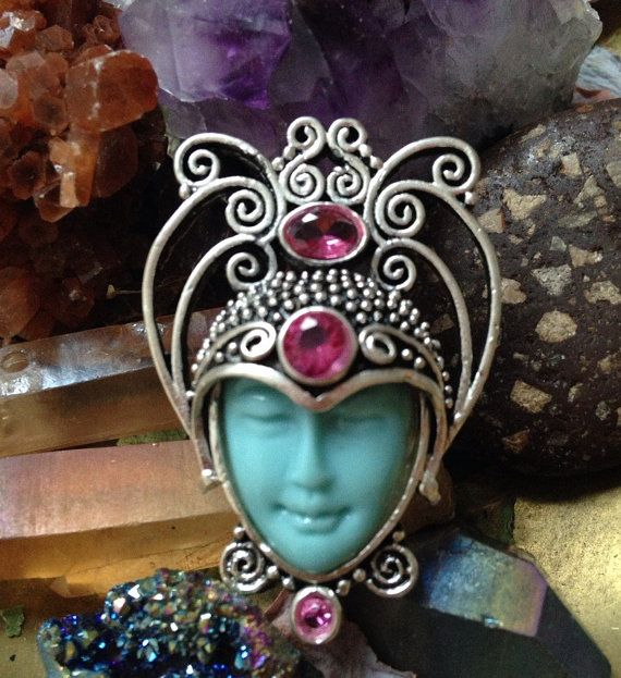Beautiful moon goddess face, sterling silver ring. Featuring Pink Topaz gemstones.