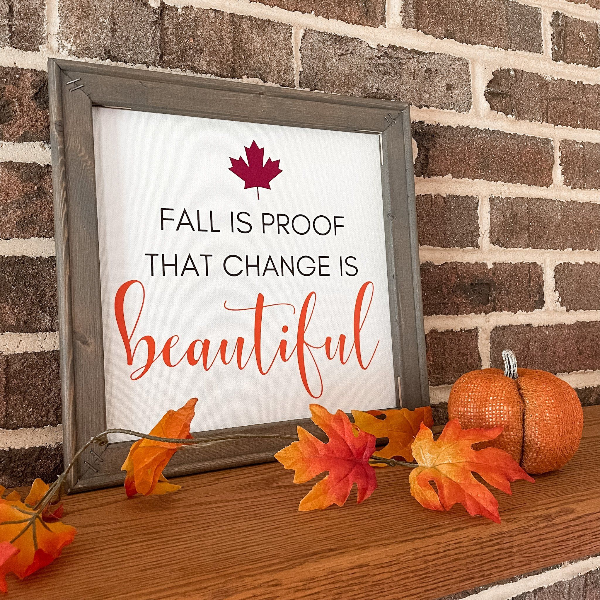 """Fall is proof that change is beautiful These unique reverse canvas signs are hand pressed with high quality heat transfer vinyl onto canvas. The frames are hand stained with a premium wood stain. Hanging hardware is included. Sign measures 14""""h x 14""""w We love custom orders! Contact us to get started!"""