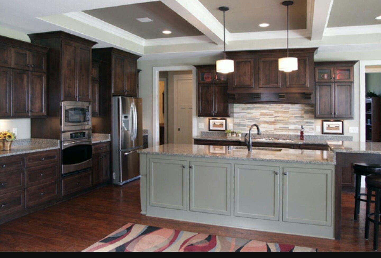 Dark brown kitchen cabinets grey island contrast