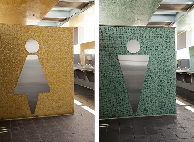 Interior Restroom Signs Are Supergraphics Rendered In Metal On