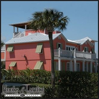 Aluminum Bahama shutters let breezes in while keeping harsh sunlight out. #aluminumshutters #Bahamashutters