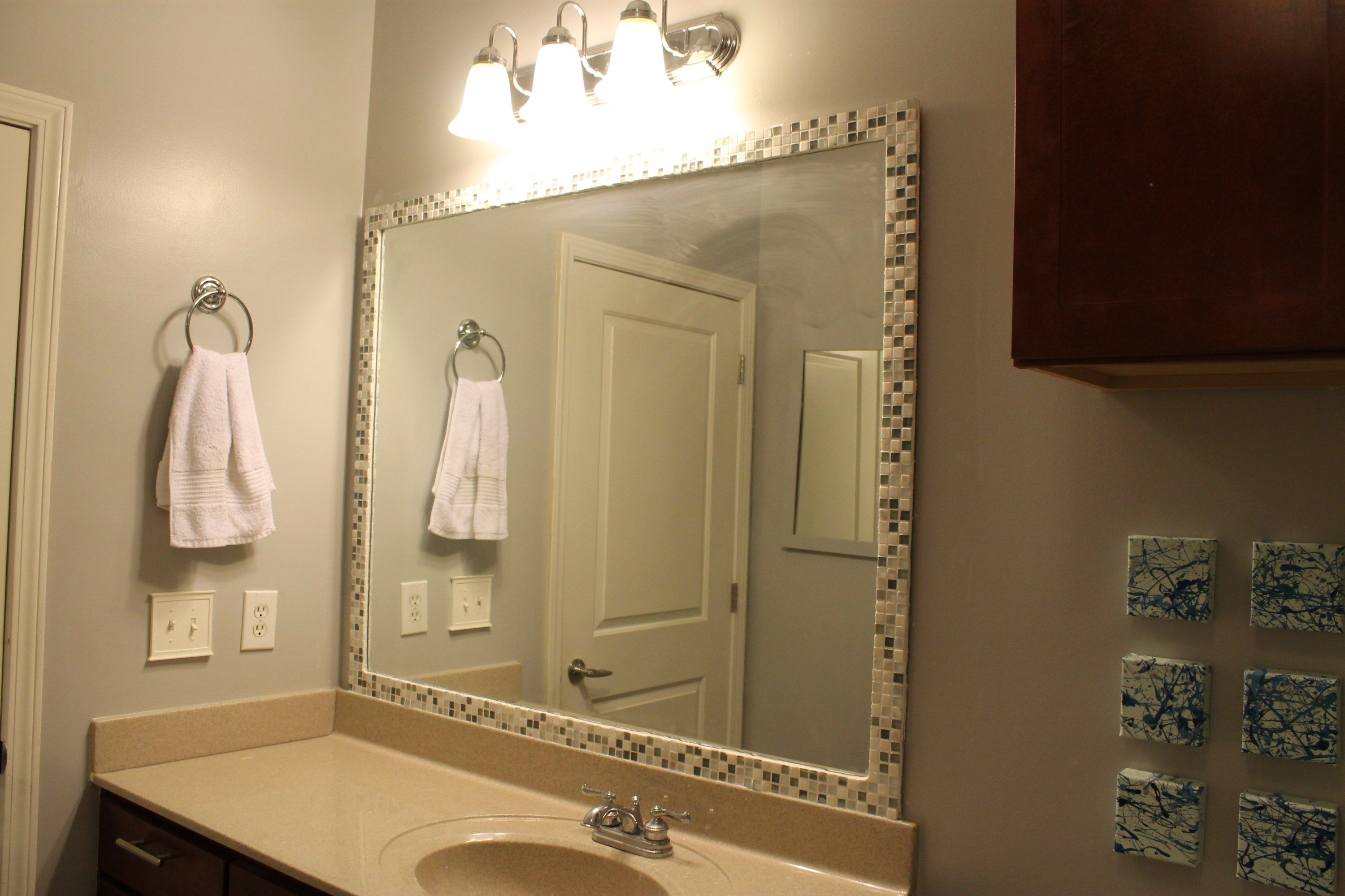 how to frame a mirror with tile | small space bathroom