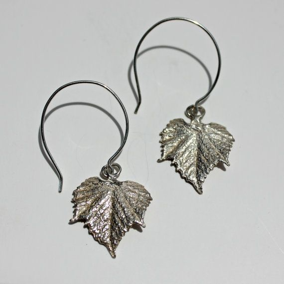These grape leaf earrings are a great addition to your jewelry box. they let you subtly wear your love of grapes - no matter how you like them. The large looped ear wires add an extra flair to these earrings that creates a beautiful dangle.  The leaves themselves are about 1 tall and 3/4 across at the largest point. Including the ear wire, they dangle 1 3/4 off the ear. The ear wires and grape leaves are all sterling silver.  I used an actual grape leaf to make a mold. I then filled that…
