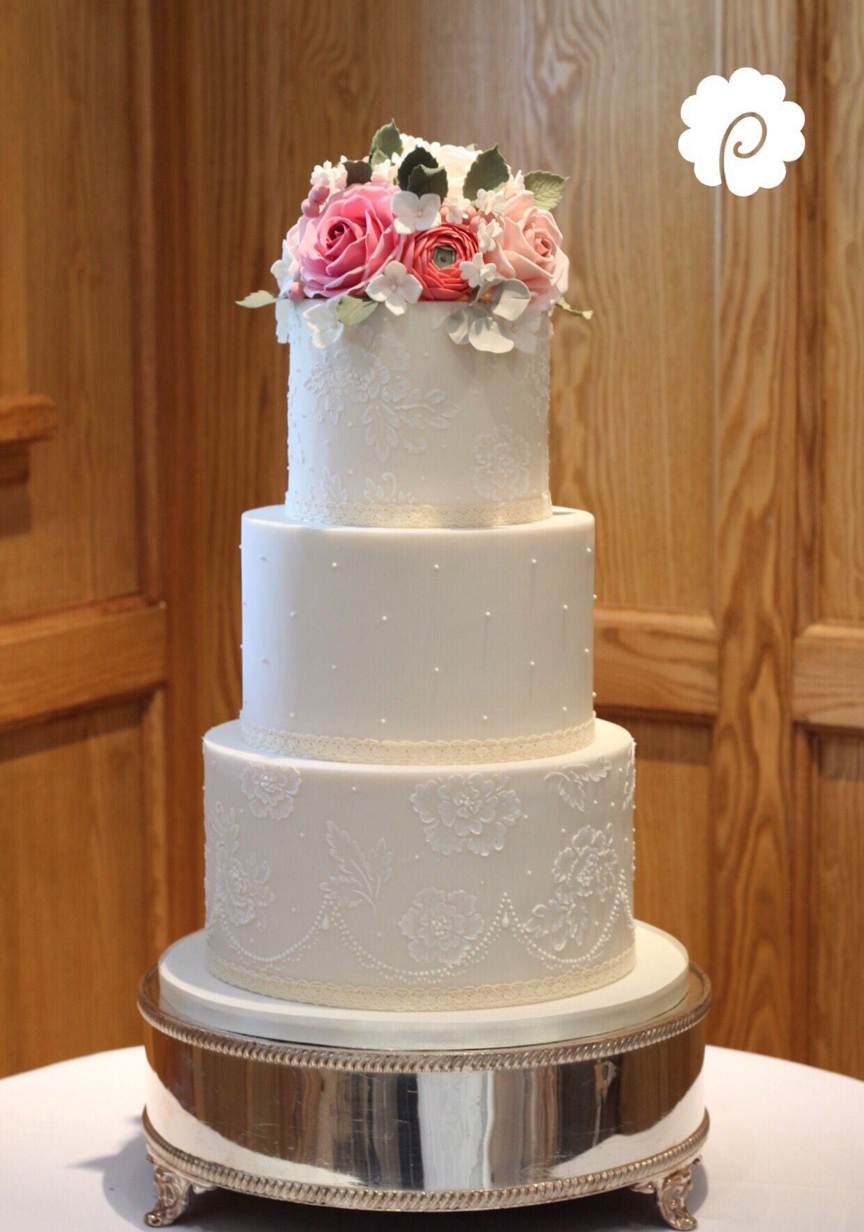 Vintage rose wedding cake with delicate iced brushwork effect