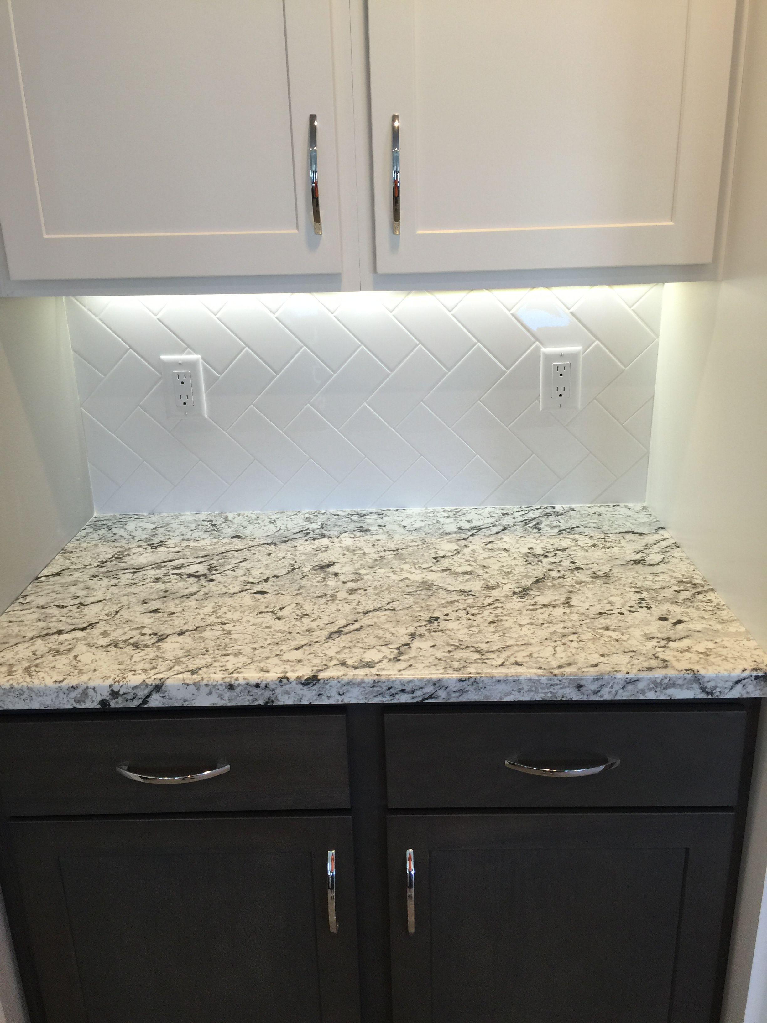 Kitchen backsplash in a white 3x6 subway tile in a vertical