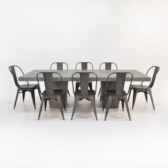 Concrete table set from Teak Warehouse includes one raw concrete table and eight Alix chairs. & Concrete table set from Teak Warehouse includes one raw concrete ...