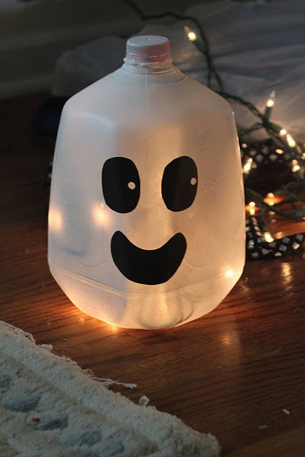 maybe use a strand of orange lights? halloween Pinterest Milk - halloween milk jug decorations
