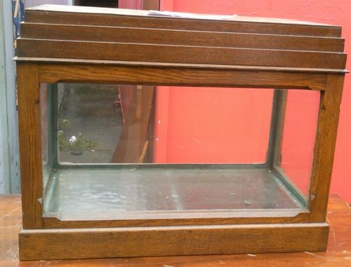 Antique aquarium - Made by Harry Gerrard in 1952. Item is an exact copy of the fish tank sir Winston Churchill had during ww2 in the bunker he was in. The item is made from oak beams salvaged from the bombed out remains of the Manchester free trade hall & built & exhibited at an aquarium exhibition in Manchester in 1952.