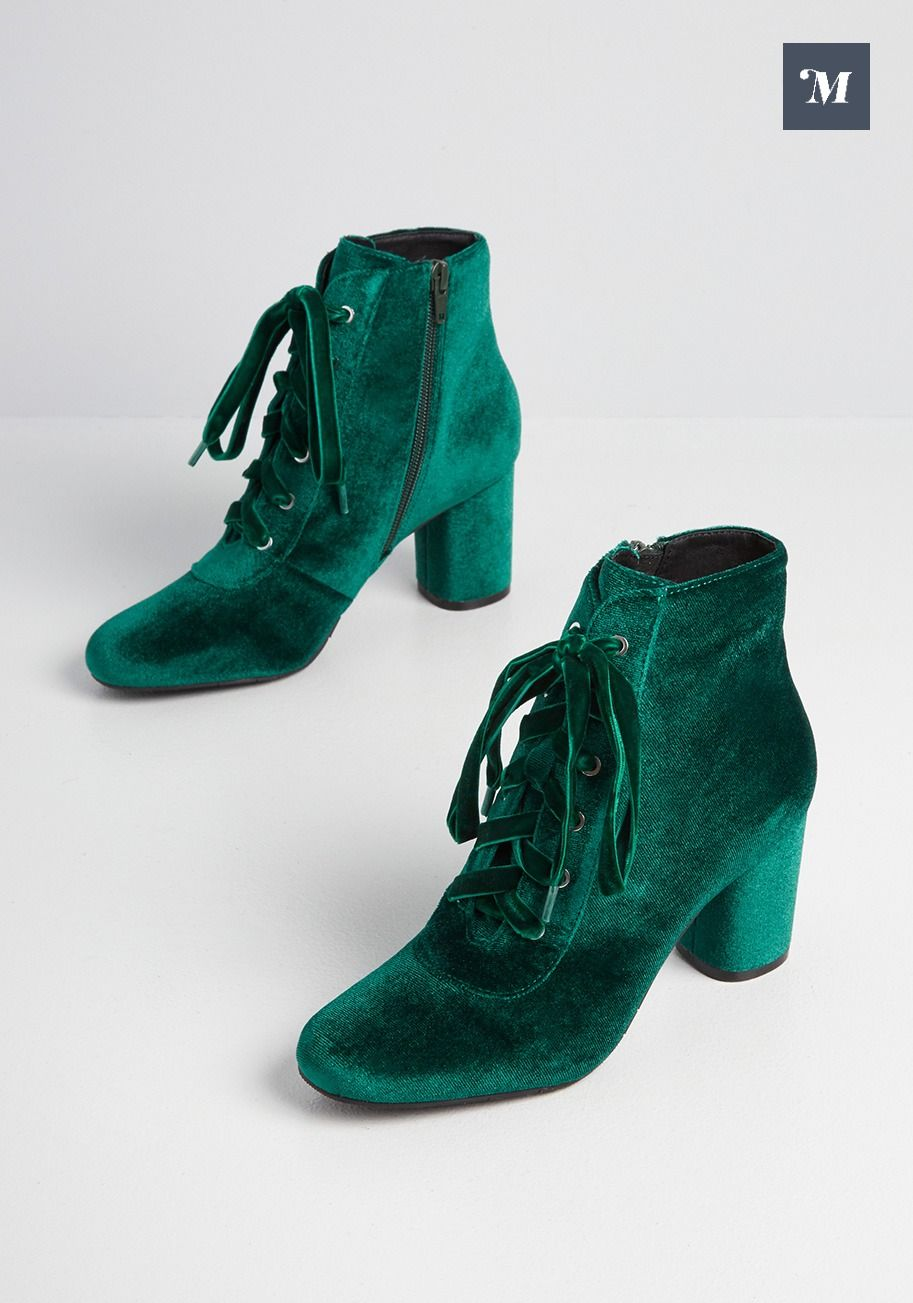Make each step a lux one in these green velvet boots. Laces at the front and a zipper at the side makes slipping into these statement makers a breeze. Walk confidently with a chunky block heel prodiving style and support wherever you plan to go. #ModCloth #shoesforwomen #vintageshoes #shoetrends #heels #highheels #boots #fallboots #booties #heeledboots #velvetboots