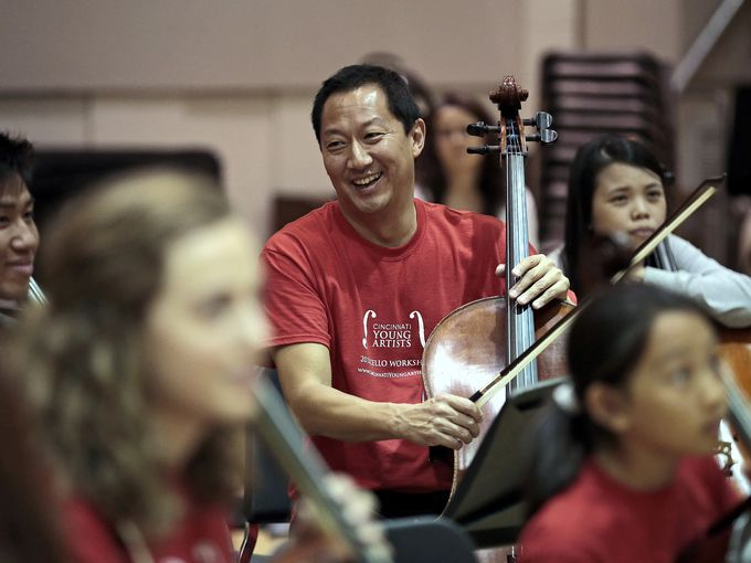 50 cellos to play national anthem at UC game. Photo: University of Cincinnati president Santa Ono laughs with fellow cellists during a practice session in a rehearsal room at the College-Conservatory of Music on the UC campus. The Enquirer/Sam Greene