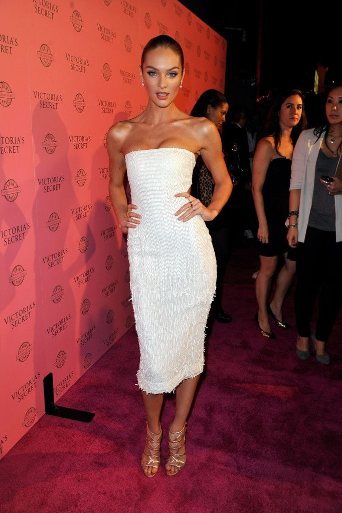 da0253b2c0 Candice Swanepoel accented her fitted white strapless dress with gold  strappy gladiator heels.