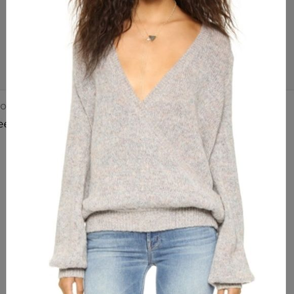 Free People Karina Wrap Sweater Free People Karina Wrap Sweater  Layer up in style with this classic wrap pullover from Free People. A slouchy wrap-style sweater in a cozy loose knit. Ribbed edges and long peasant sleeves. Like new, no signs of wear. Free People Sweaters V-Necks