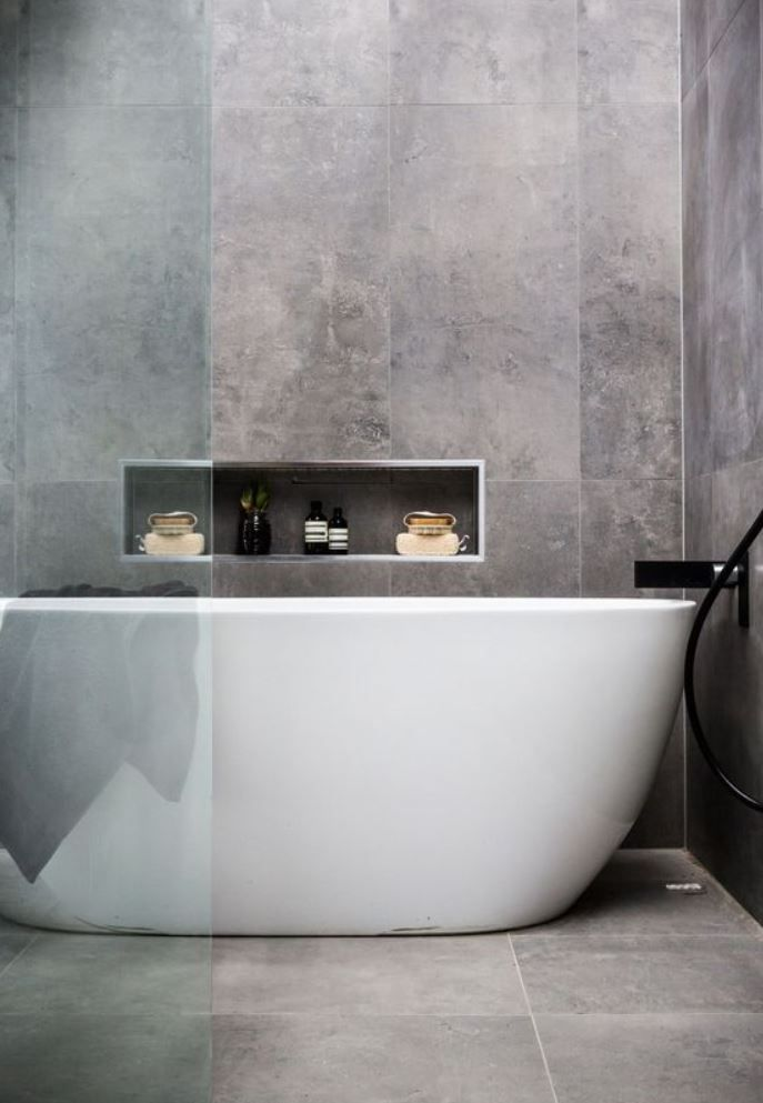 Simple Raw Concrete Look Walls And Floor With White Free Standing Bath Niche At Bath Contemporary Bathroom Tiles Modern Bathroom Grey Bathroom Tiles