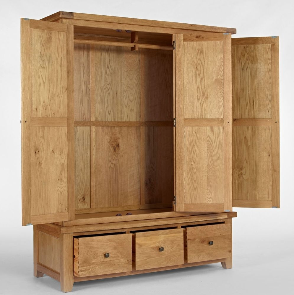 Carson solid oak bedroom furniture triple wardrobe with drawers ...