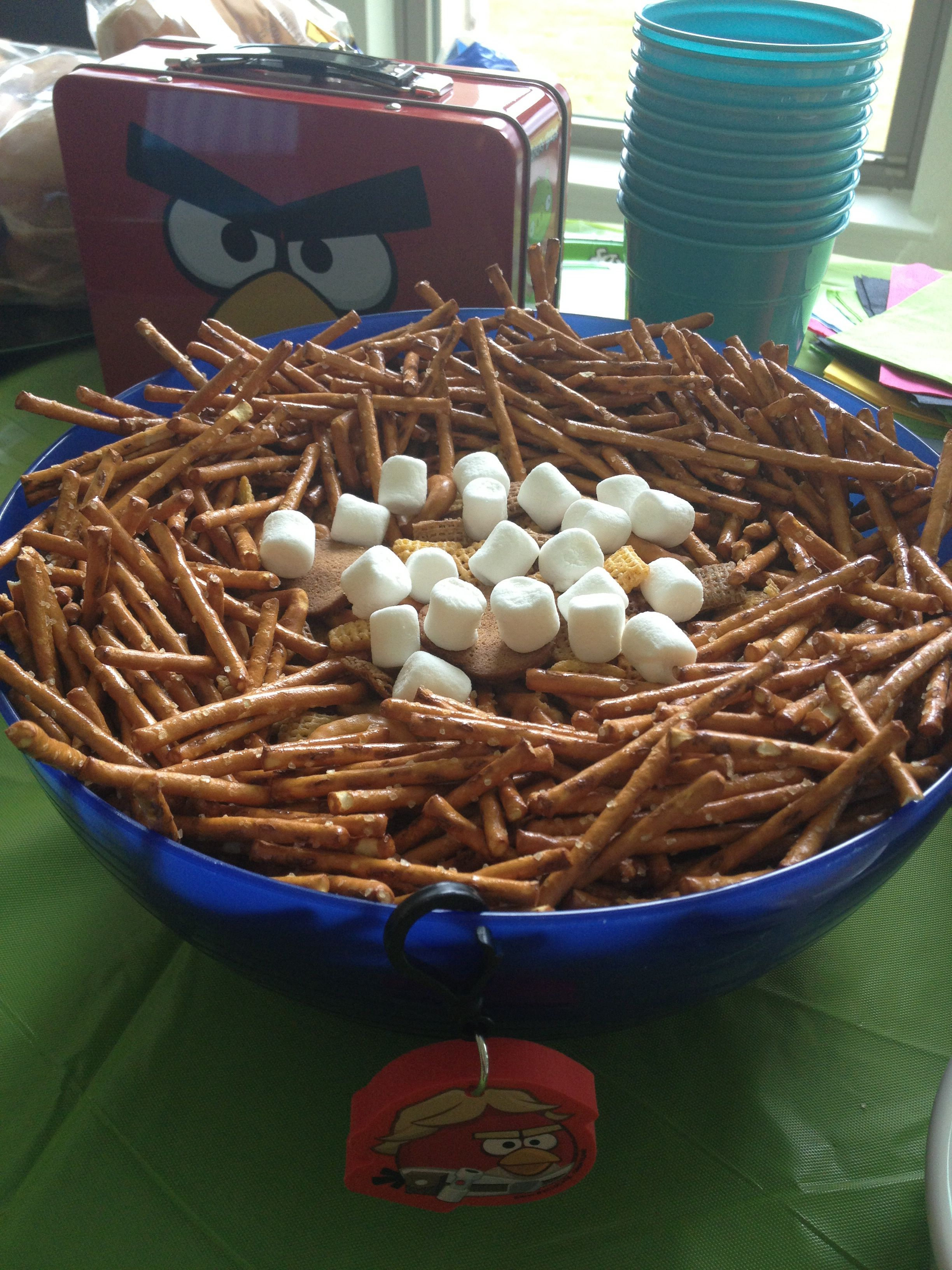 Angry bird party food - bird food chez mix with pretzel sticks and marshmallows for eggs in the nest