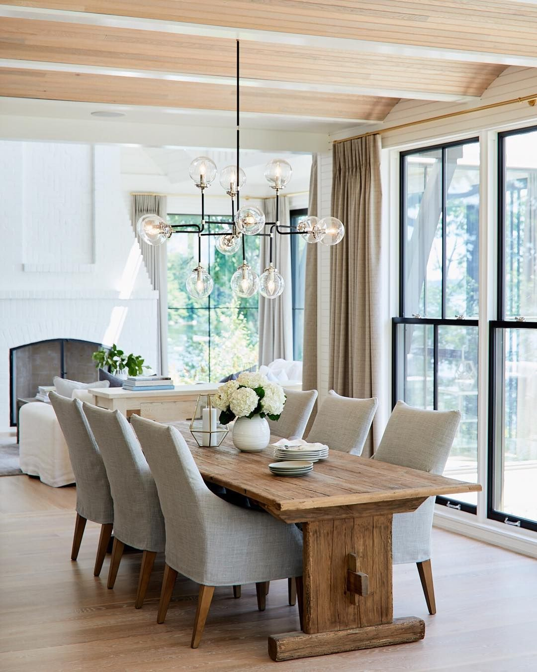 Dining Room With Light Wood Table And Fabric Chairs Modern