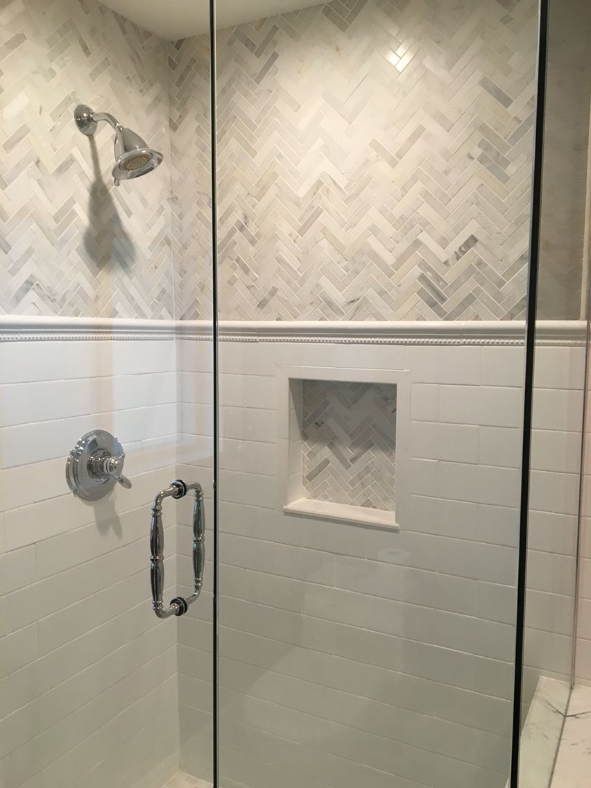 love the this shower and the gray and white tile, chevron marble