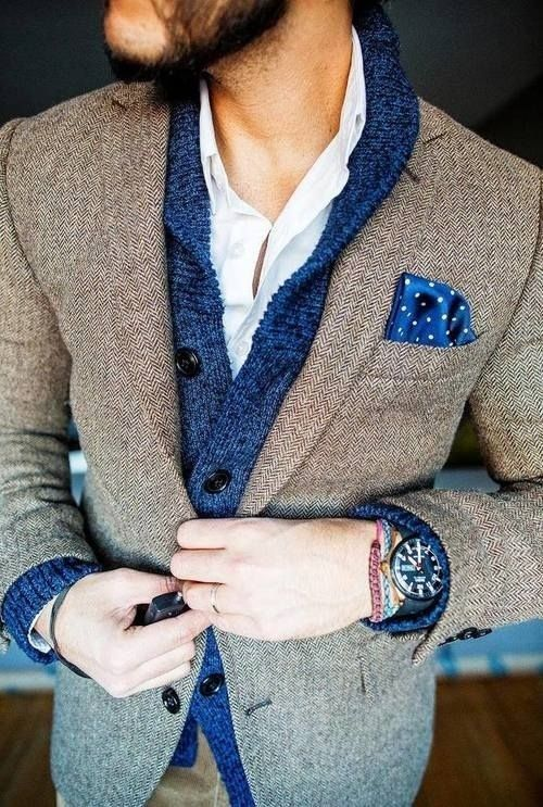 Shop this look on Lookastic: http://lookastic.com/men/looks/brown-blazer-and-blue-shawl-cardigan-and-blue-pocket-square-and-white-longsleeve-shirt/410 — Brown Herringbone Blazer — Blue Shawl Cardigan — Blue Polka Dot Pocket Square — White Long Sleeve Shirt