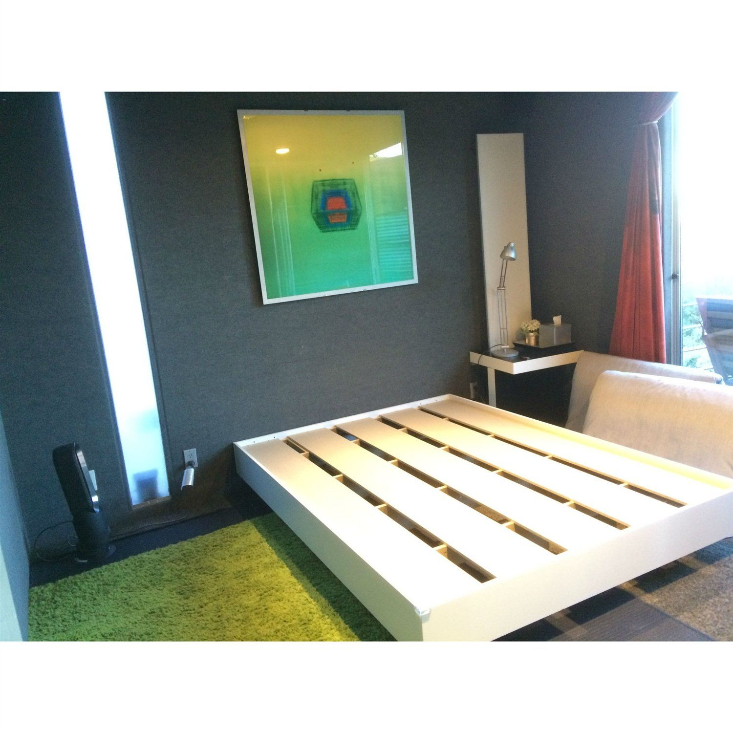 This Modern Floating Style White Platform Bed Frame in