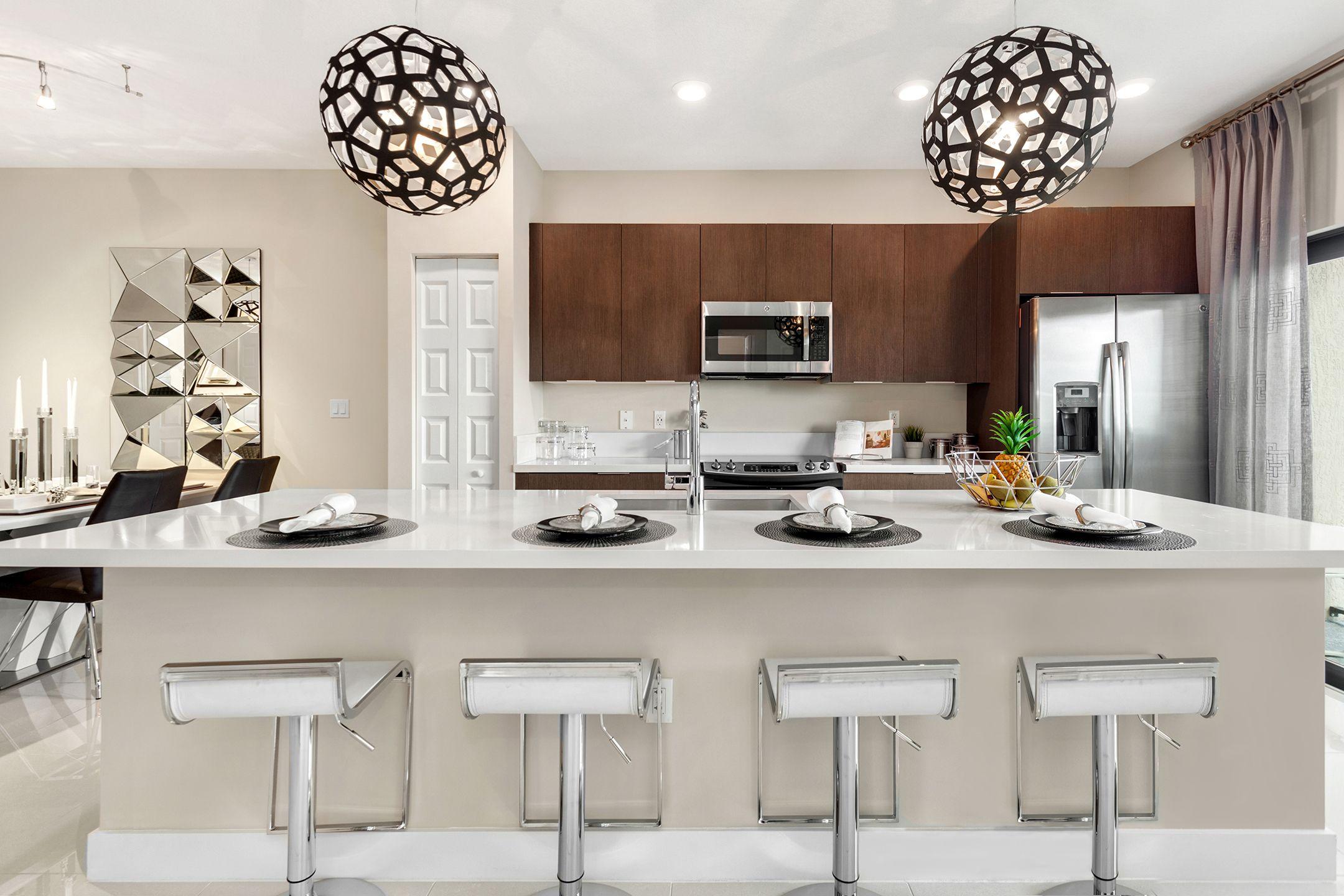 Modern Kitchen Design At Apex In Park Centralu0027s Cascade Home. Brown  Cabinets | Quartz Countertop