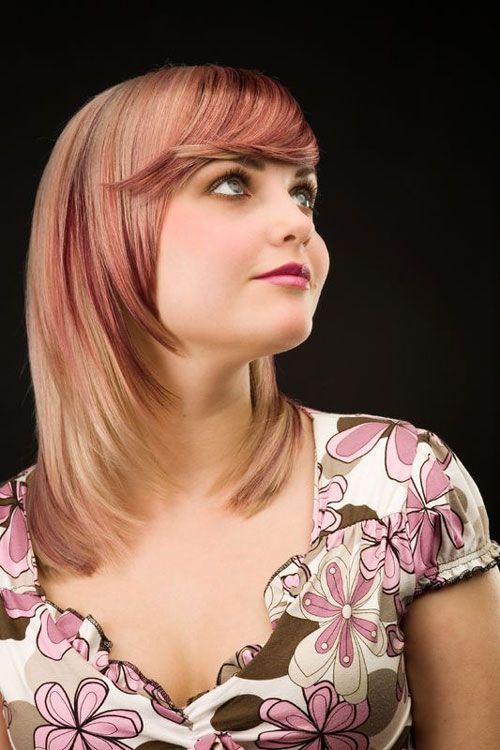 Perfectly trimmed lovely golden blonde hair will look gorgeous with radiant red streaks.