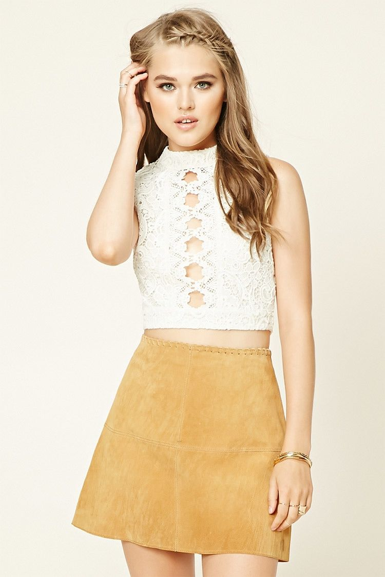 A crop top featuring an allover crochet lace design, front cutouts, high neckline, exposed back zipper, and a sleeveless cut.