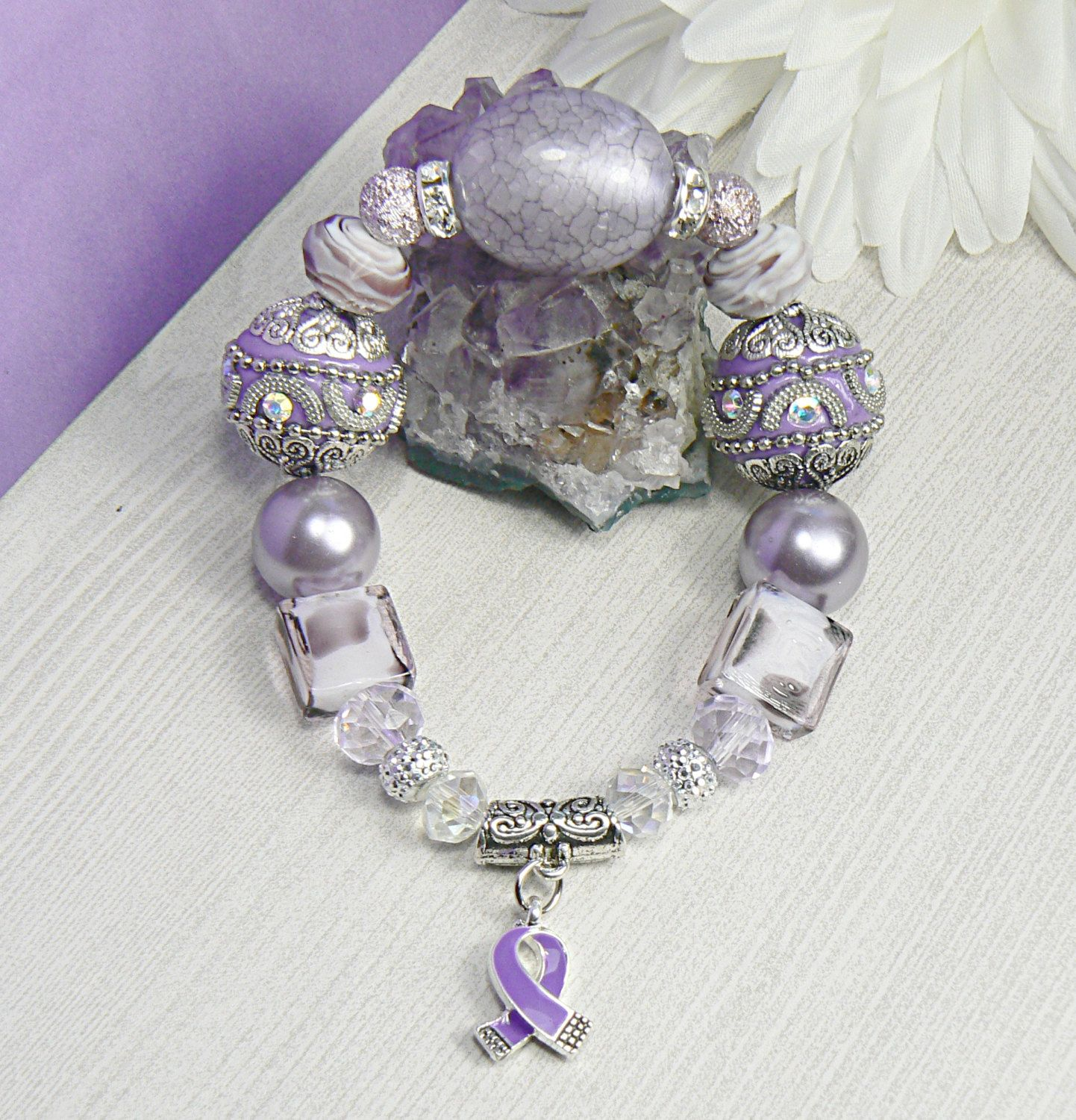 to five donated every bracelet pin dollars gemstone awareness january s alzheimer month purchased for obsidian is society