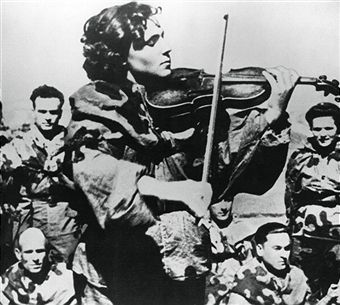 Russian army nurse playing a violin, Eastern Front, 1944. Tonia Magdanskaya entertaining the troops during a pause in the fighting. Pin by Paolo Marzioli