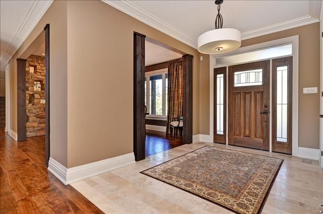 Stunning Entry And Unique Wood Columns Framing The Dining Room Entrance