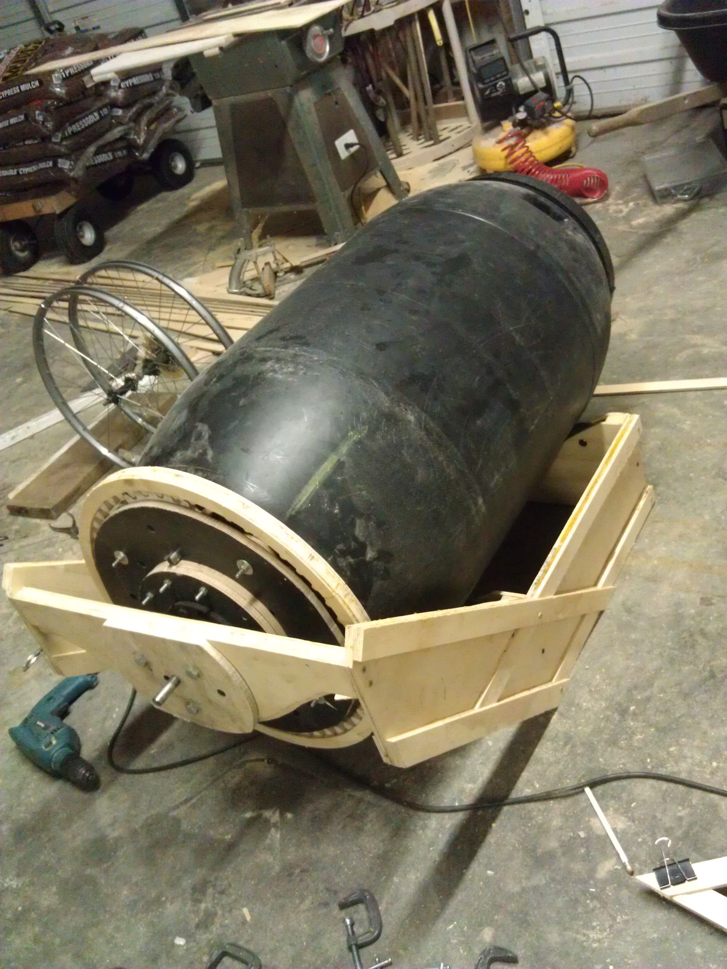 Wheelbarrow Concrete Mixer By Dynamodan Homemade Concrete Mixer Adapted From A Pickle Barrel And Mounted To Concrete Mixers Concrete Concrete Diy