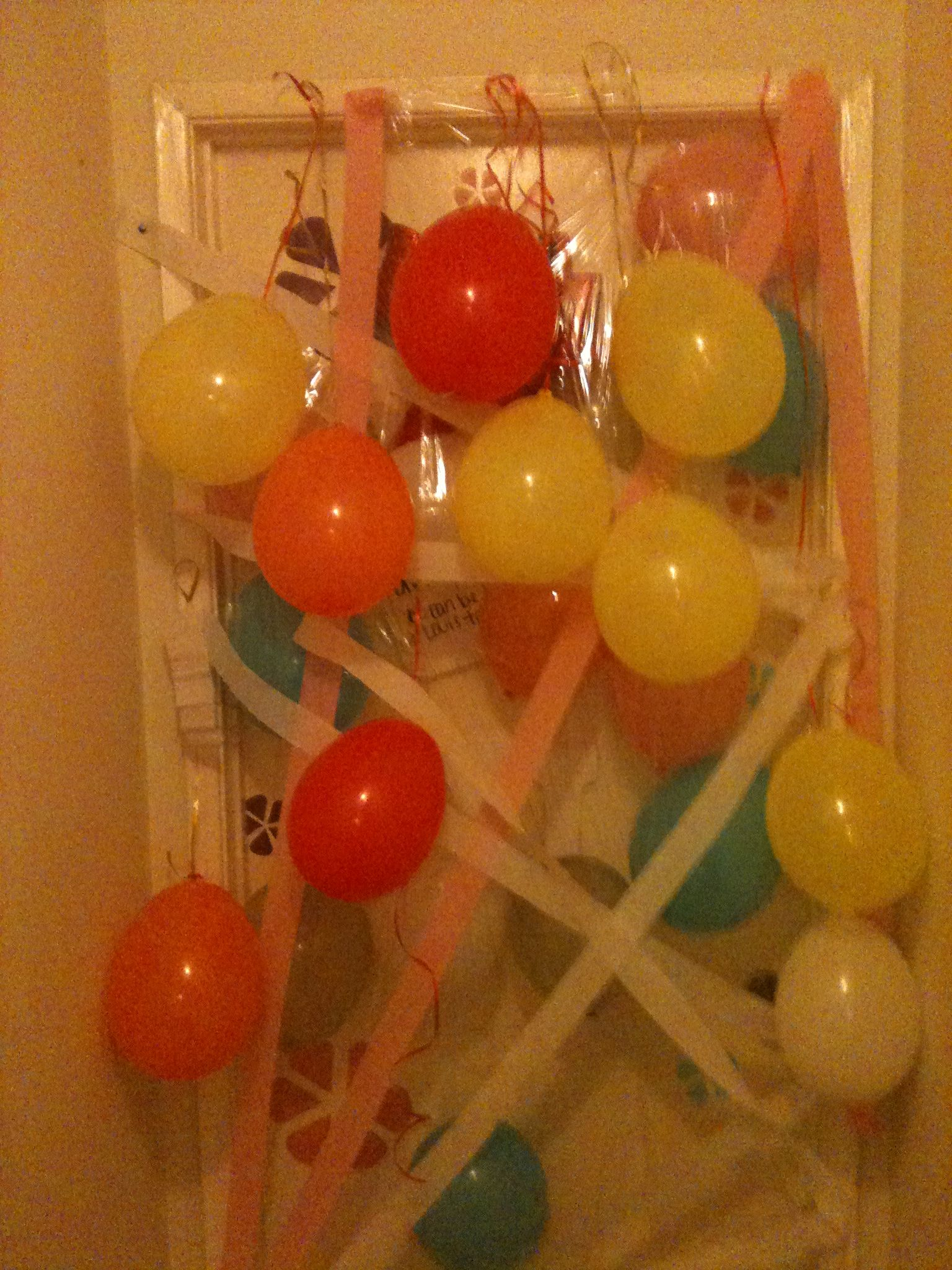 Balloons sealed with plastic wrap to fall in when the door ...