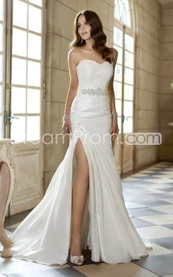 Wedding gown with high slit. Very elegant.