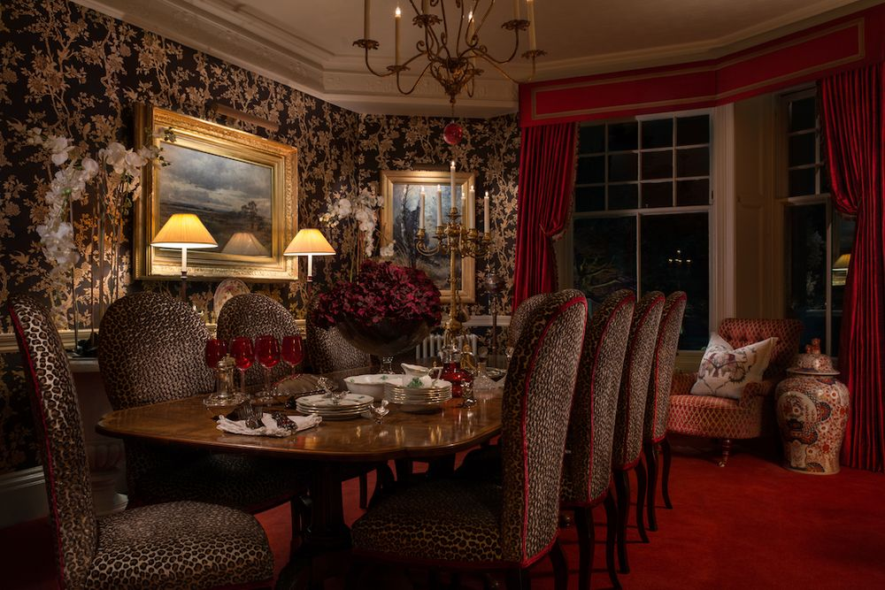 Dark and moody dining room with animal print upholstered ...