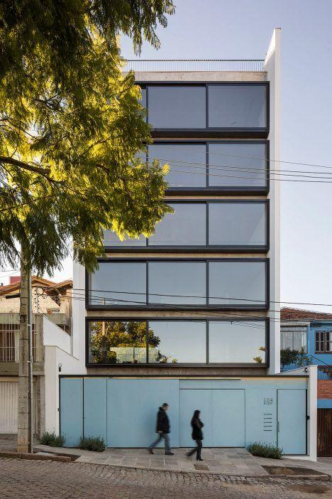 Sliding windows make up the facade of this apartment building in the Brazilian city of Porto Alegre