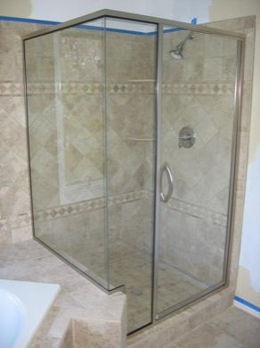 semi frameless shower enclosure with a 90 degree glass to glass return panel this door