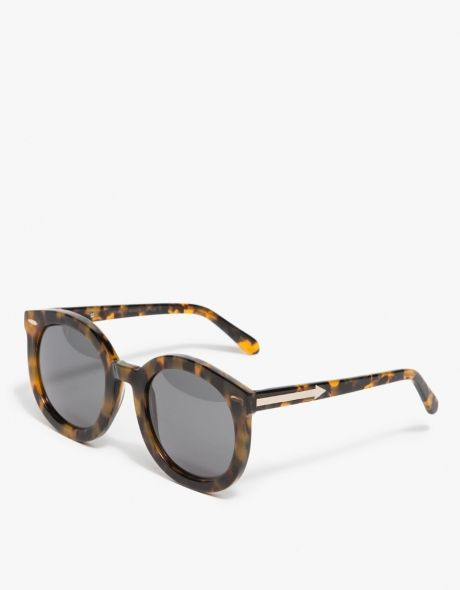 84abc1478ad Retro-inspired oversized rounded sunglasses from Karen Walker. Features  handmade acetate frame with signature