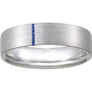 The Modern Horizon Sapphire Ring Features A Thin Vertical Row Of Blue  Sapphires Against A Matte