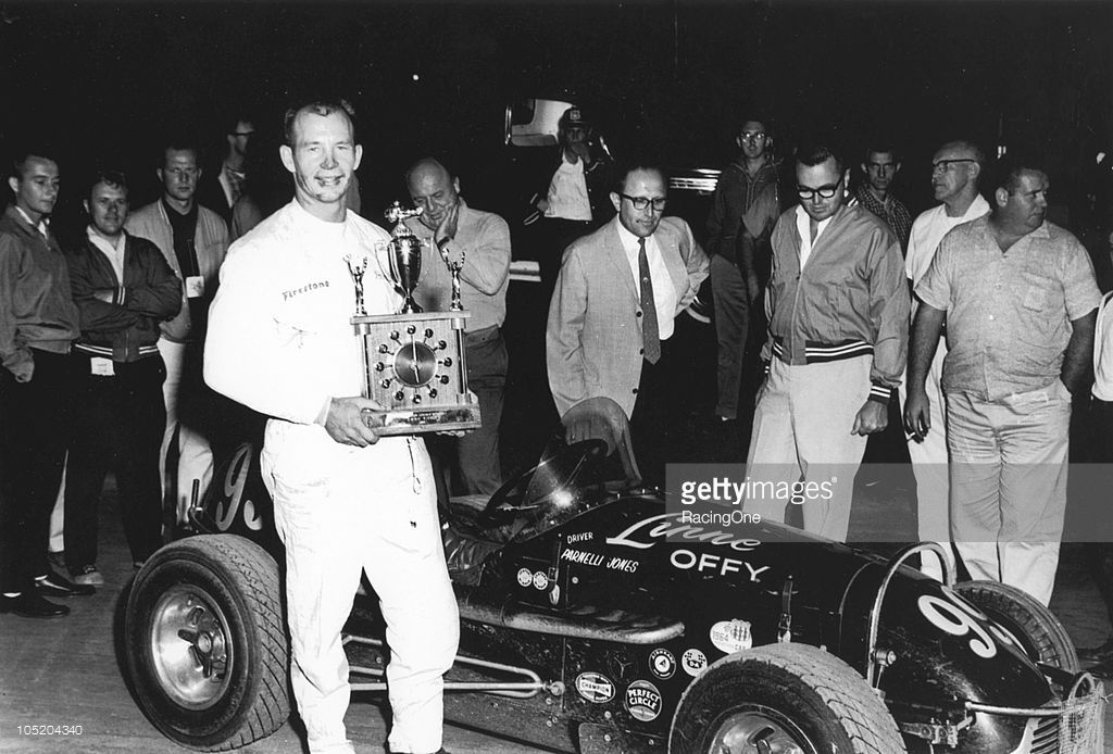 Parnelli Jones poses with a combination trophy and clock