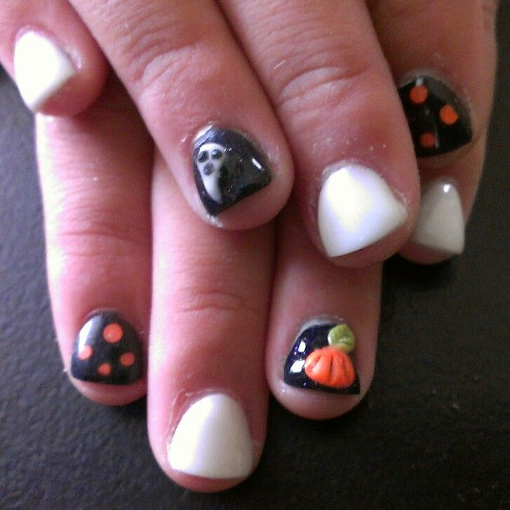 Baby girl with full acrylic halloween theme.