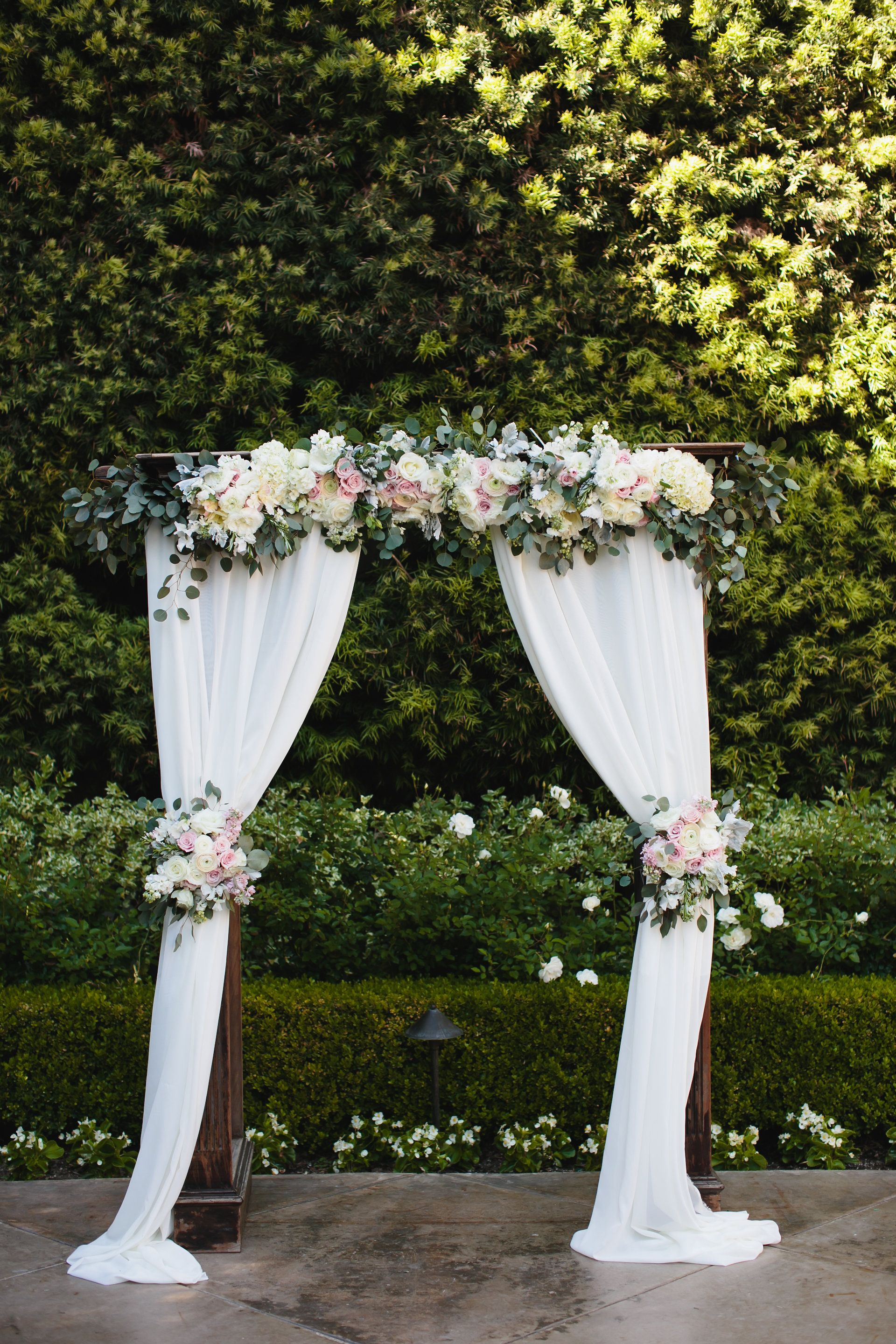 Blush And White Wedding Arch At Franciscan Gardens Draping Fabric Curtains With Roses