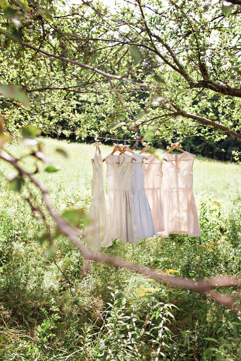 Hand-sewn bridesmaids dresses--the bride sew each one with a different color fabric for each bridesmaid! Massachusetts Wedding Photographer | Montague Retreat Center | Amilia Photography