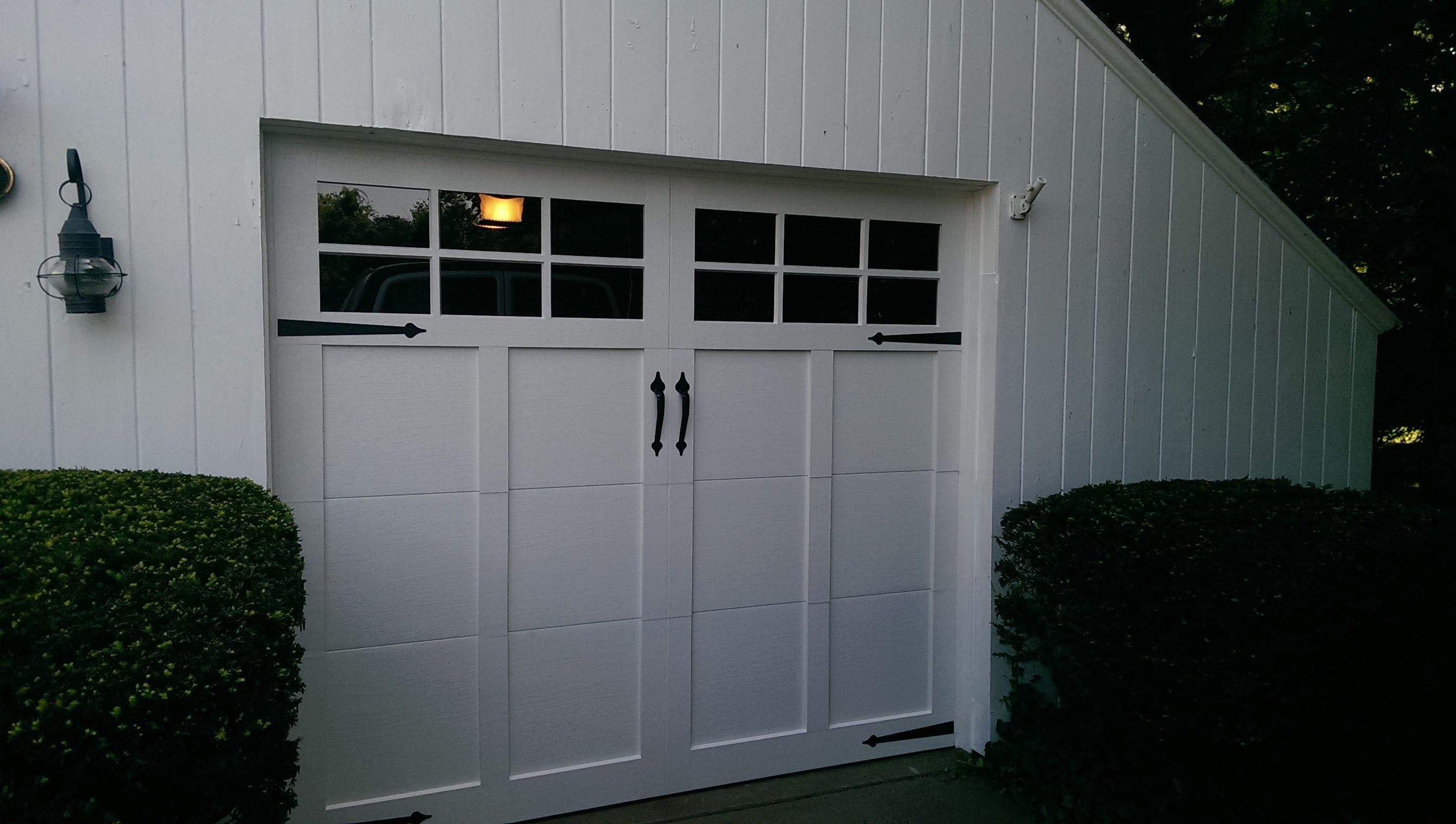 ... Carriage House Garage Doors In White With 6 Pane Glass U0026 Flat Black  Spade Decorative Hardware. Installed By Mortland Overhead Door.  Mortlanddoor.com