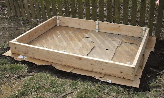 put cardboard under raised flower bed to keep grass and weeds out