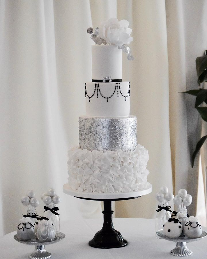 Beautiful white and silver wedding cake with flowers