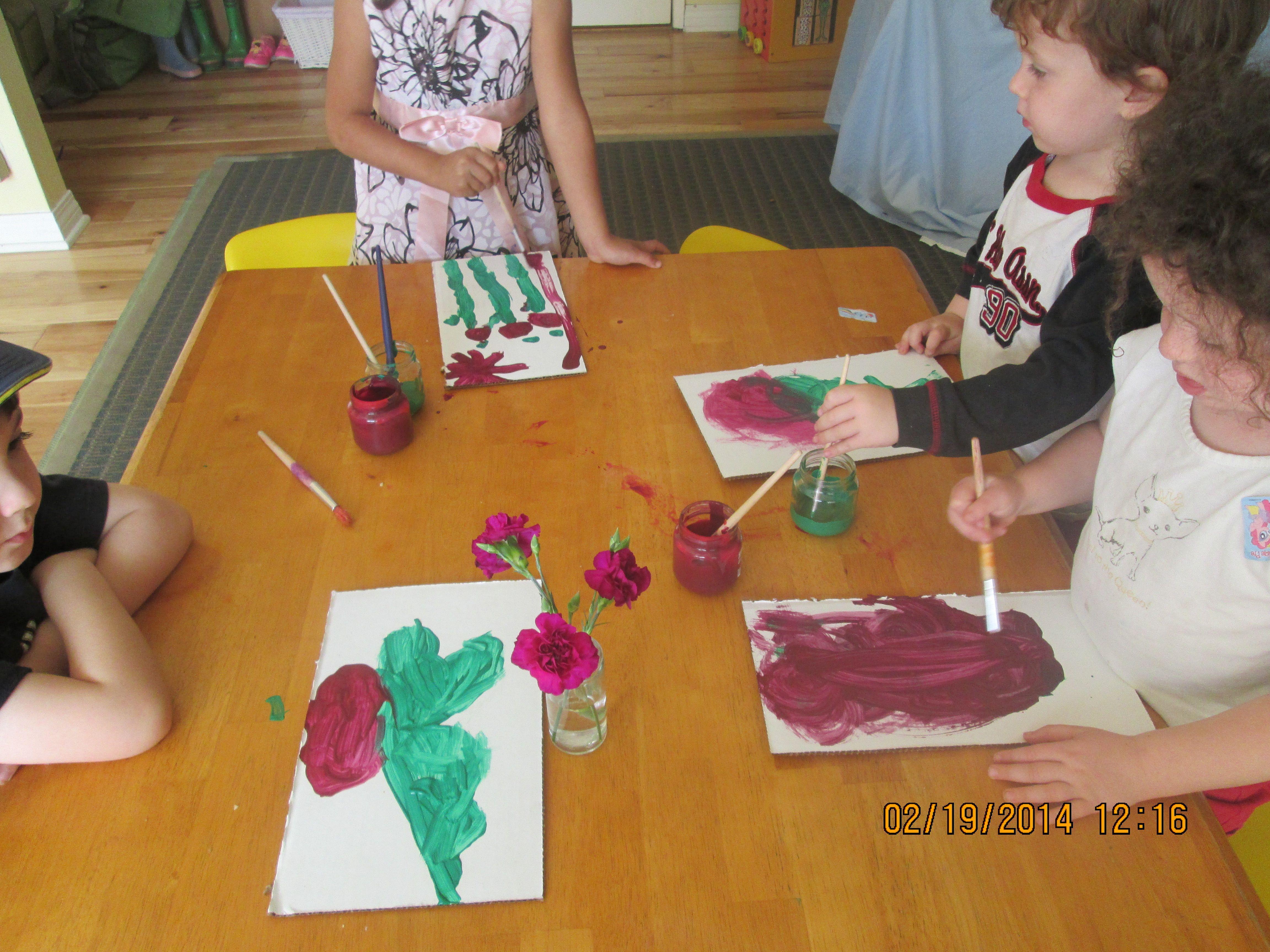 Painting flowers with preschoolers.